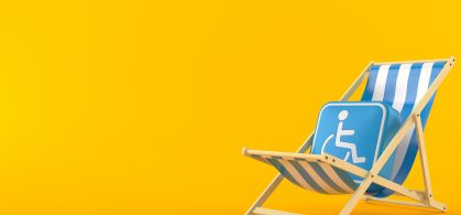 An-image-of-a-disabled-badge-a-blue-square-with-wheelchair-icon-sitting-on-a-deckchair-on-a-yellow-background.-scaled
